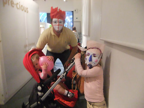 A masked family at the Animal Tales storytelling session