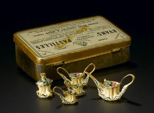 Miniature tea set of painted fish bones