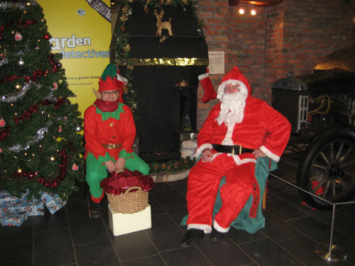 Santa and his elf greet visitors