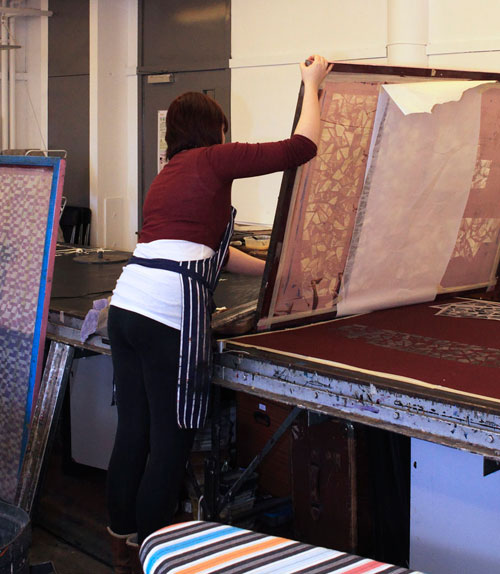 Students at work in the studio preparing garments for the fashion show