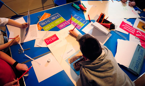 Pupils designing posters for their exhibition