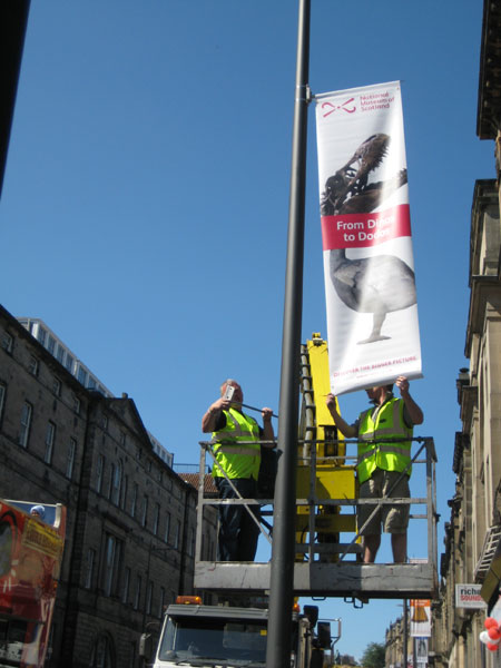 Putting up banners on Chambers Street