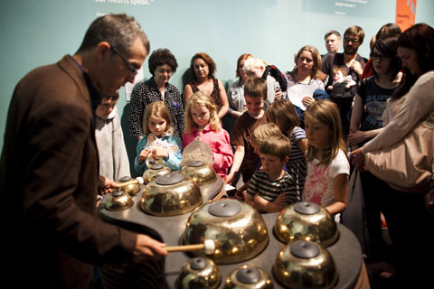 Victor Gama demonstrates one of his instruments, Tipaw, at the opening of the National Museum of Scotland