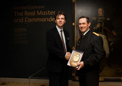 Admiral Edmundo Gonzalez, Commander-in-Chief of the Navy of Chile, presents a gift to National Museums Scotland to mark the exhibition Admiral Cochrane, The Real Master and Commander.