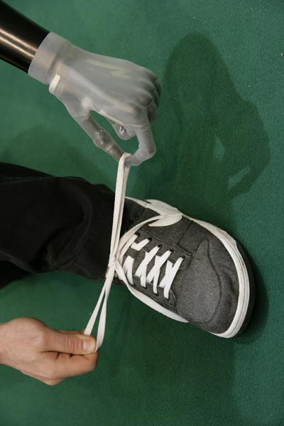 Tying shoelaces using the i-limb ultra prosthetic hand. Photo © Touch Bionics.