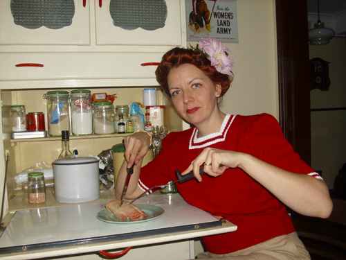 Edna tucking into a pig's trotter in the 1940s kitchen