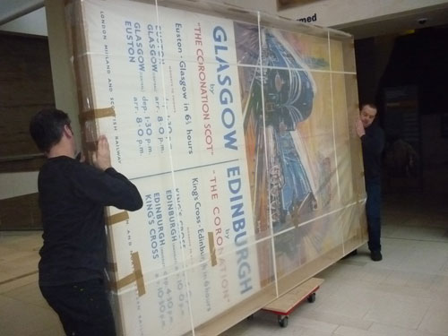 Moving the poster through the museum
