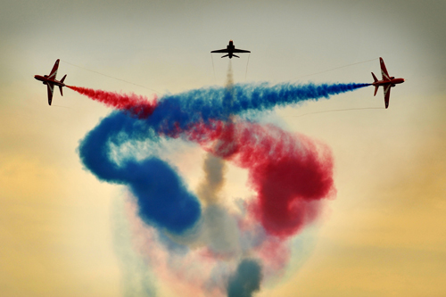 Red Arrows with smoke on © MOD Crown Copyright