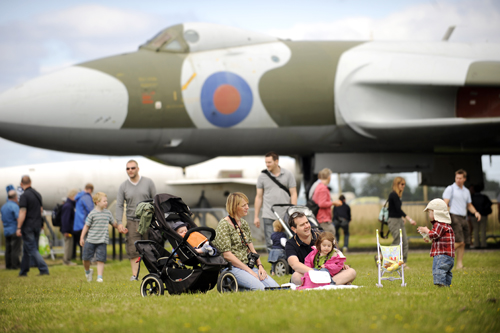 Airshow visitors seated in front of the Vulcan bomber at the Airshow, National Museum of Flight, East Fortune in 2011