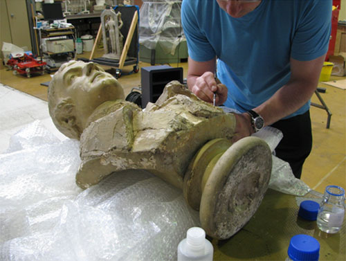 Stabilising the fragile painted surface on the bust of Robert Burns.