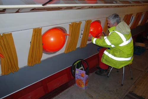 Inserting Space Hoppers to the windows on the Comet 4c at National Museum of Flight, East Fortune
