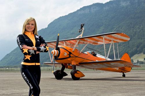 Freya Seymour aka Princess Breitling Wingwalker posing with Stearman display aircraft © Richard Seymour