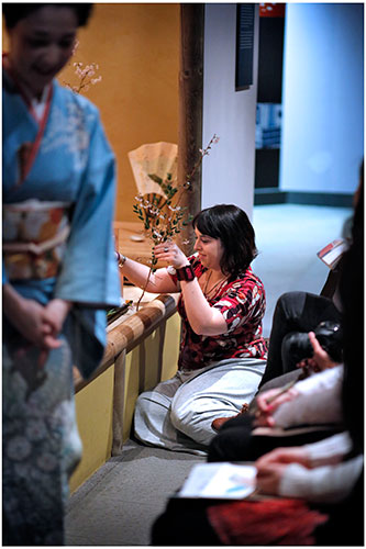 A student arranging foliage before the ceremony. Photo by Paul Dodds.