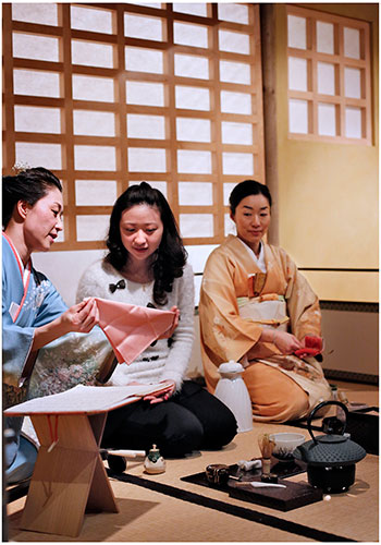 A University of Edinburgh student learns the etiquette of the Japanese tea ceremony. Photo by Paul Dodds.