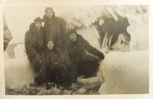 Photo of men on iced up deck, from the Arctic Convoys exhibition