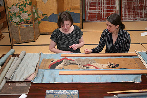 Examining the scroll in the Restorient studio