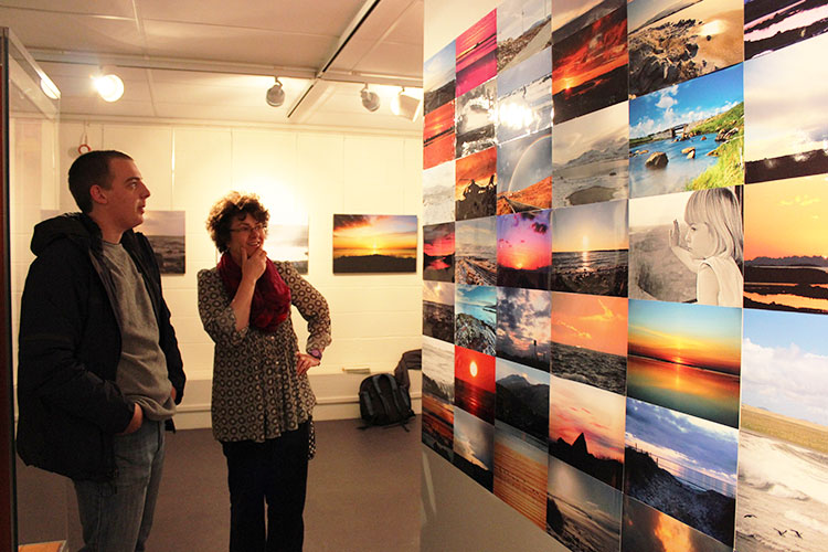Scotland Creates volunteer Peter shows Community Engagement Manager Christine McLean round the exhibition