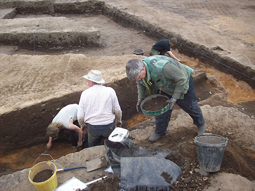 Digging out a hollow inside one roundhouse where animals were stabled