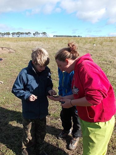 Optimistic future archaeologists showing off their finds.