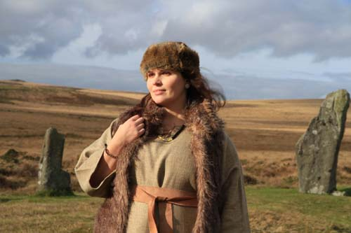 Model wearing replicas of the Whitehorse Cist ear studs, necklace and armband/bracelet, filmed on Dartmoor. Photo: DNPA/BBC
