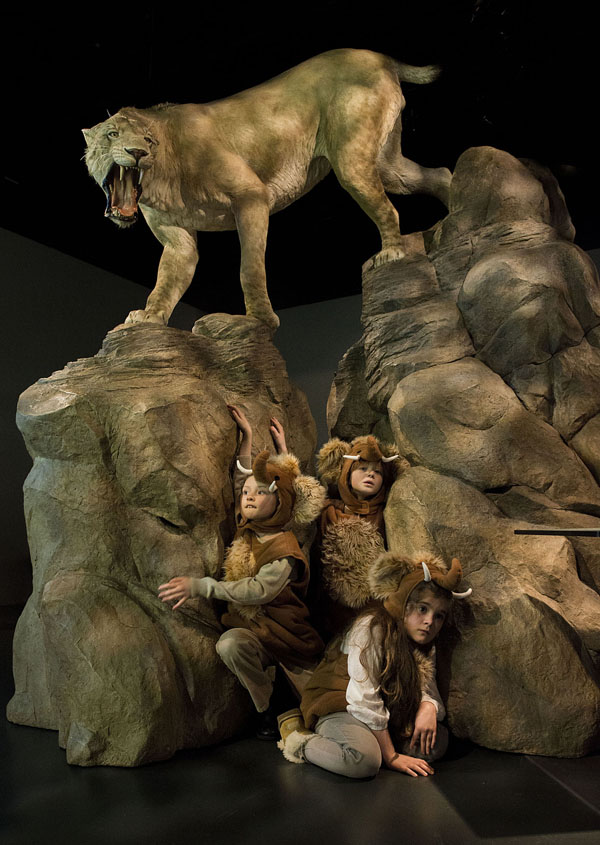 Alexander, Morag and Jessica hiding in the Mammoths of the Ice Age exhibition © Ian Jacobs
