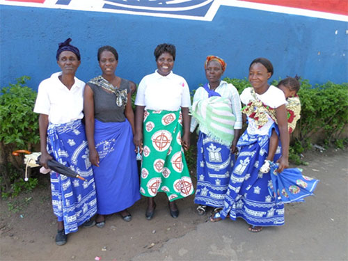 A group of women in Blantyre town centre wearing different cloths of the Evangelical Church of Malawi, 1 April 2014