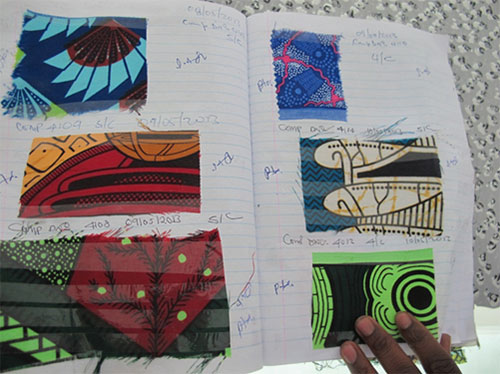 A page of the cloth design catalogue, each pattern given a unique design number, at DWS Mapeto Factory, Blantyre, 4 April 2014