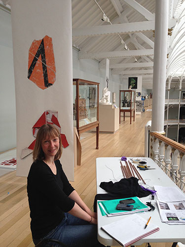 Exhibition Officer Sarah Teale in the exhibition