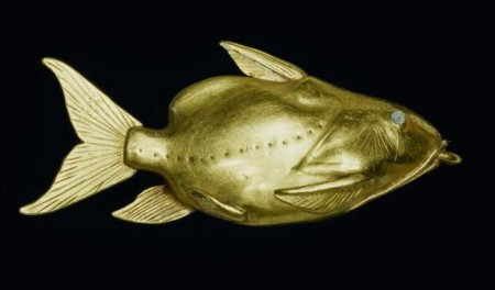 A gold pendant in the form of a catfish