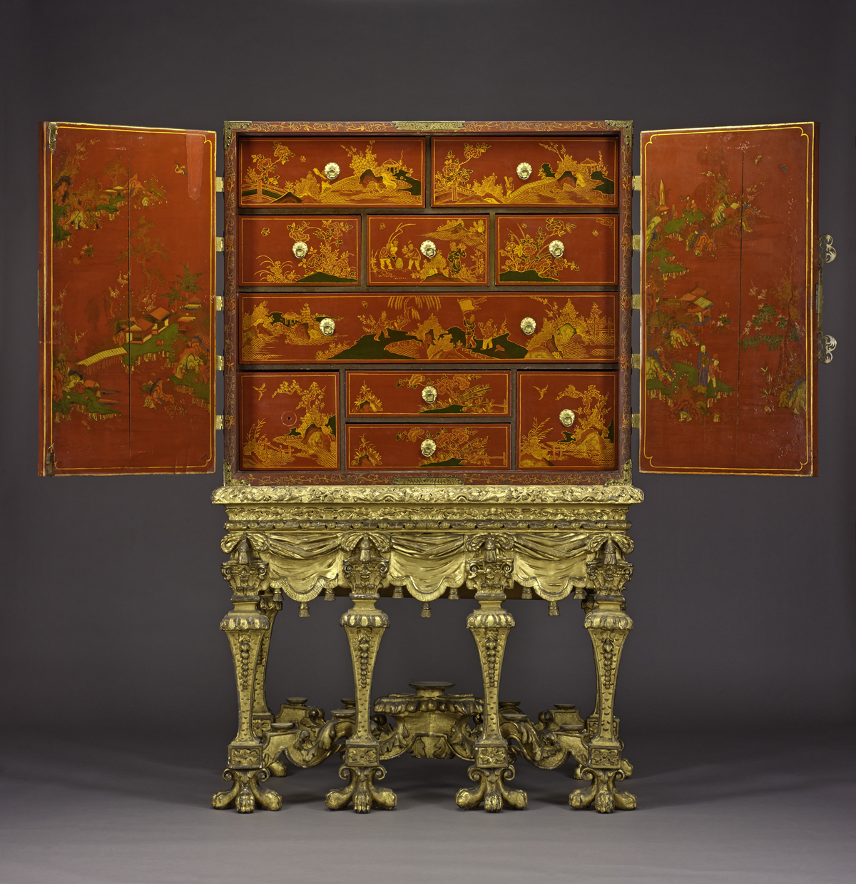 A.1921.44 - Cabinet of pine and oak with brass mounts, painted with pseudo-Chinese scenes on a red lacquer ground: English, c. 1685 – 1695.