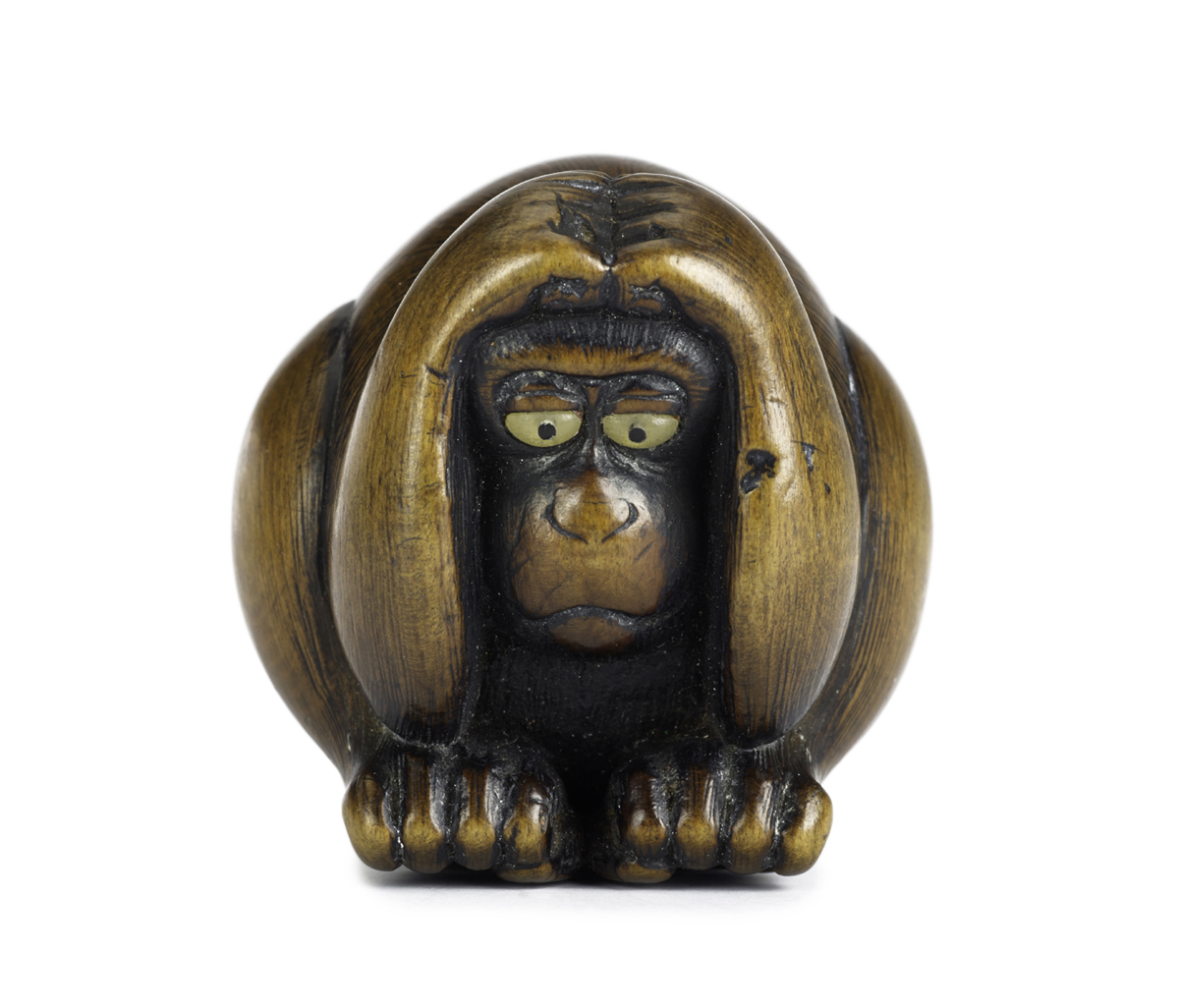 A.1946.740 - Netsuke of carved wood, a monkey crouching with hands on head, signed: Japan, by Nansui.