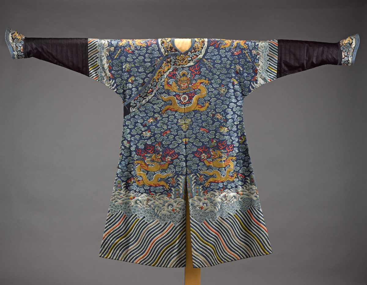 A.1973.8 - Longpao (dragon robe) of blue and aubergine silk, with horse-hoof cuffs showing Manchu influence, part of a man's court outfit: China, Qing Dynasty, late 19th century AD.