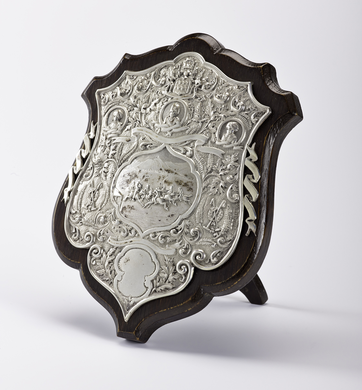 T.1998.80 - Silver polo trophy or badge with marks of Cameron of Kilmarnock and J. Ramsay of Dundee, hallmarked Glasgow, 1904 - 1905, mounted on wood.