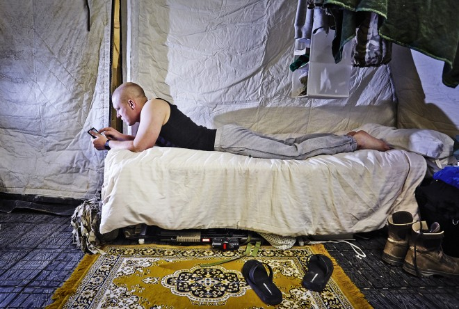 Downtime in tented accommodation at Camp Bastion © Robert Wilson