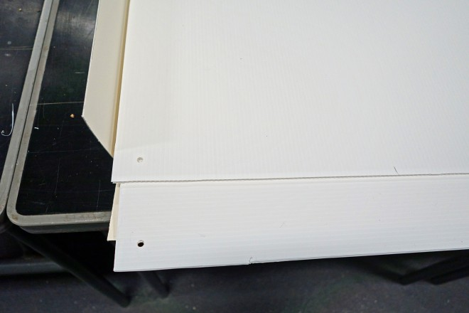 Correx sheets cut in 90 degrees orientation and with holes drilled in corner.