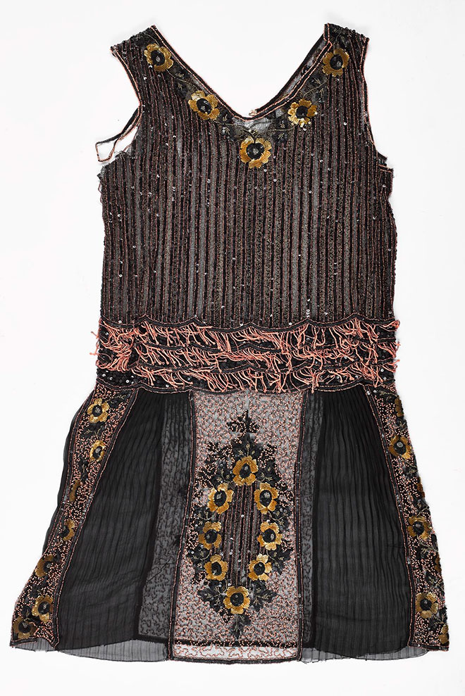 The beaded dress before conservation