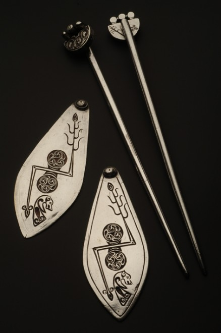 The pair of handpins and Pictish symbol-decorated plaquesThe pair of handpins and Pictish symbol-decorated plaques