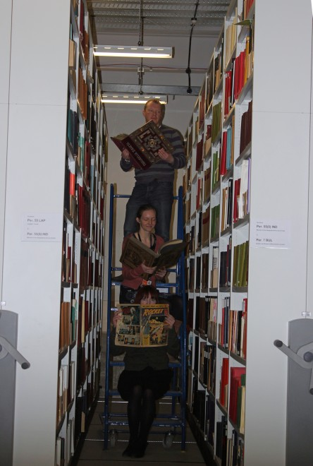 Some of the Library team working hard in one of our storage areas!