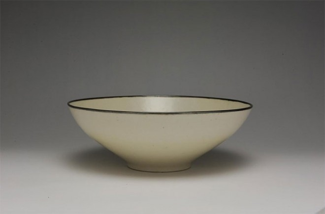 Conical bowl with a metal rim