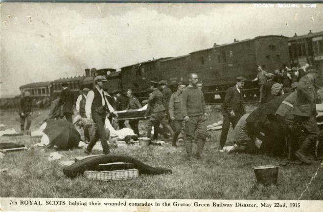 Postcard showing men, including Royal Scots soldiers, rescuing the wounded from the train wreckage. © Dumfries Museum