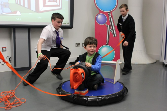 Pupils from Holy Rood RC High, performing the science show Alex's Amazing Adventure at the National Museum of Scotland.