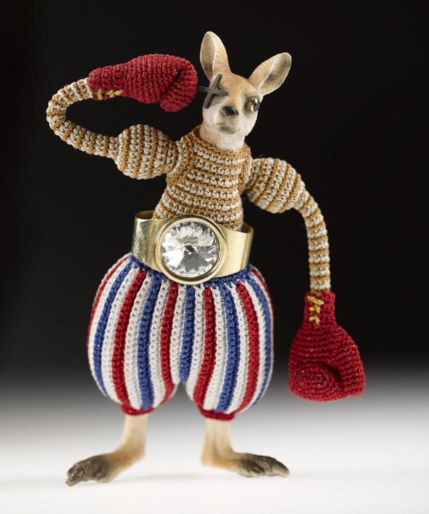 Billy Bang brooch, textile, plastic animal, gold, Swarovski crystal, silver and sapphire, by Felieke van der Leest, 2010.