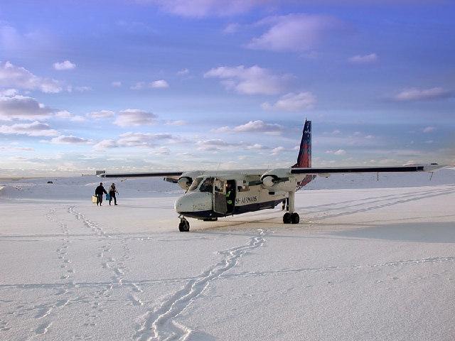 A Logan Air Britten Norman Islander landing on Fair Isle in the snow.