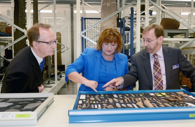 Fiona Hyslop MSP examines Viking artefects with Dr Gordon Rintoul and George Dalgleish, our Keeper of Scottish History and Archaeology.