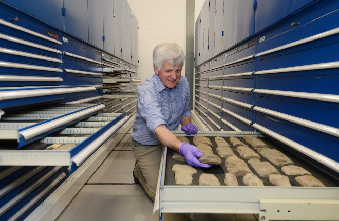 Trevor Cowie, our Senior Curator of Scottish History and Archaeology inspects stone tools from Scotland. Image © Neil Hanna