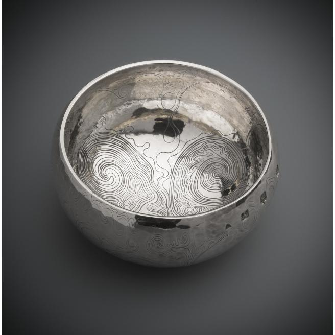 Silver bowl with a flattened hemispherical bowl with incurved rim, engraved on the exterior with irregular running scrollwork, by Malcolm Appleby,