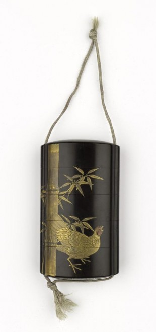 Inro or medicine case of black lacquered wood, with four compartments, with a cockerel, a hen and bamboo in relief in gold and colour: Japan, 19th century