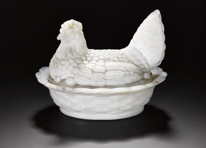 Salt dish of opaque white glass, moulded with oval basket-shaped base and lid shaped as hen on nest with egg