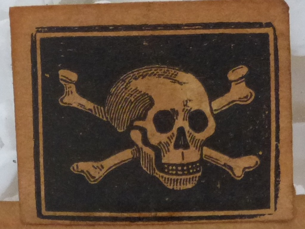 Skull and crossbones label from a bottle of arsenious acid