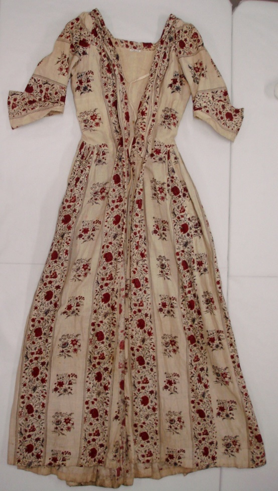 The front of the dress before conservation treatment
